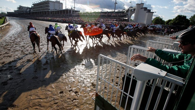 The horses bolt from the starting gate of the 143rd running of the Kentucky Derby.