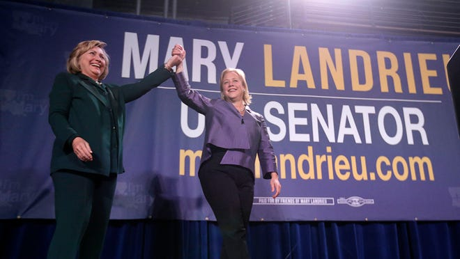 Former Secretary of State Hillary Clinton rests the crowd as she appears on stage to speak at a campaign event for Sen. Mary Landrieu, D-La., in New Orleans, Saturday, Nov. 1, 2014. (AP Photo/Gerald Herbert) ORG XMIT: LAGH102