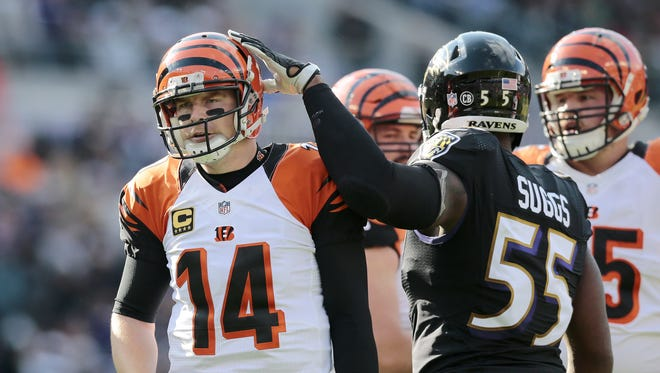 Baltimore Ravens outside linebacker Terrell Suggs (55) pats Cincinnati Bengals quarterback Andy Dalton (14) on the head after an attempted touchdown pass lands incomplete in the second quarter of the NFL Week 12 game between the Baltimore Ravens and the Cincinnati Bengals at M&T Bank Stadium in Baltimore on Sunday, Nov. 27, 2016. After one half, the Ravens led the Bengals 16-3.