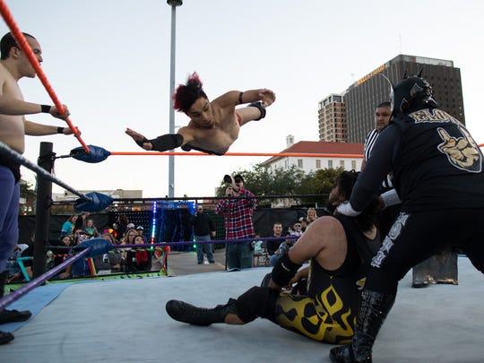 Lucha Kaboom! wrestling during the 10th annual Dia de los Muertos Street festival in downtown Corpus Christi on Saturday, Oct. 28, 2017.
