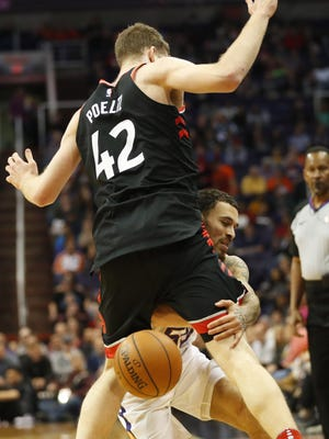 Phoenix Suns guard Mike James (55) loses the ball around Toronto Raptors center Jakob Poeltl (42) during the second quarter at Talking Stick Resort Arena in Phoenix, Ariz. December 13, 2017.