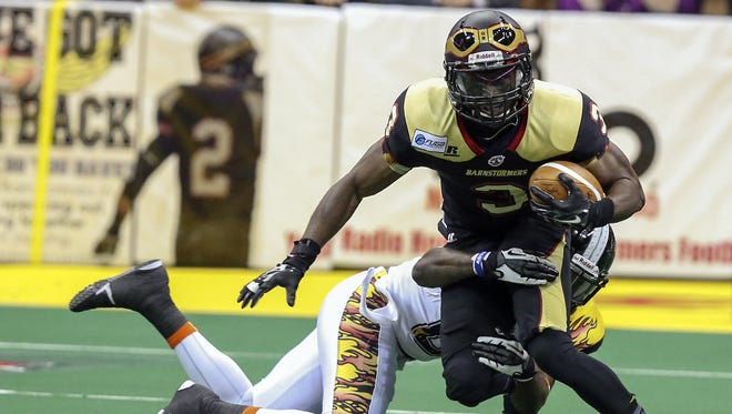 Iowa Barnstormers wide receiver Marco Thomas is brought down by a defender from the LA KISS during an Arena Football League game between the Iowa Barnstormers and the LA KISS on Saturday, April 19, 2014, at Wells Fargo Arena in Des Moines, Iowa.
