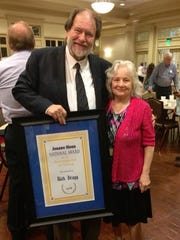 Rick Bragg accepts an award at the 2018 Southern Christian Writers Conference. He is shown with Joanne Sloan.