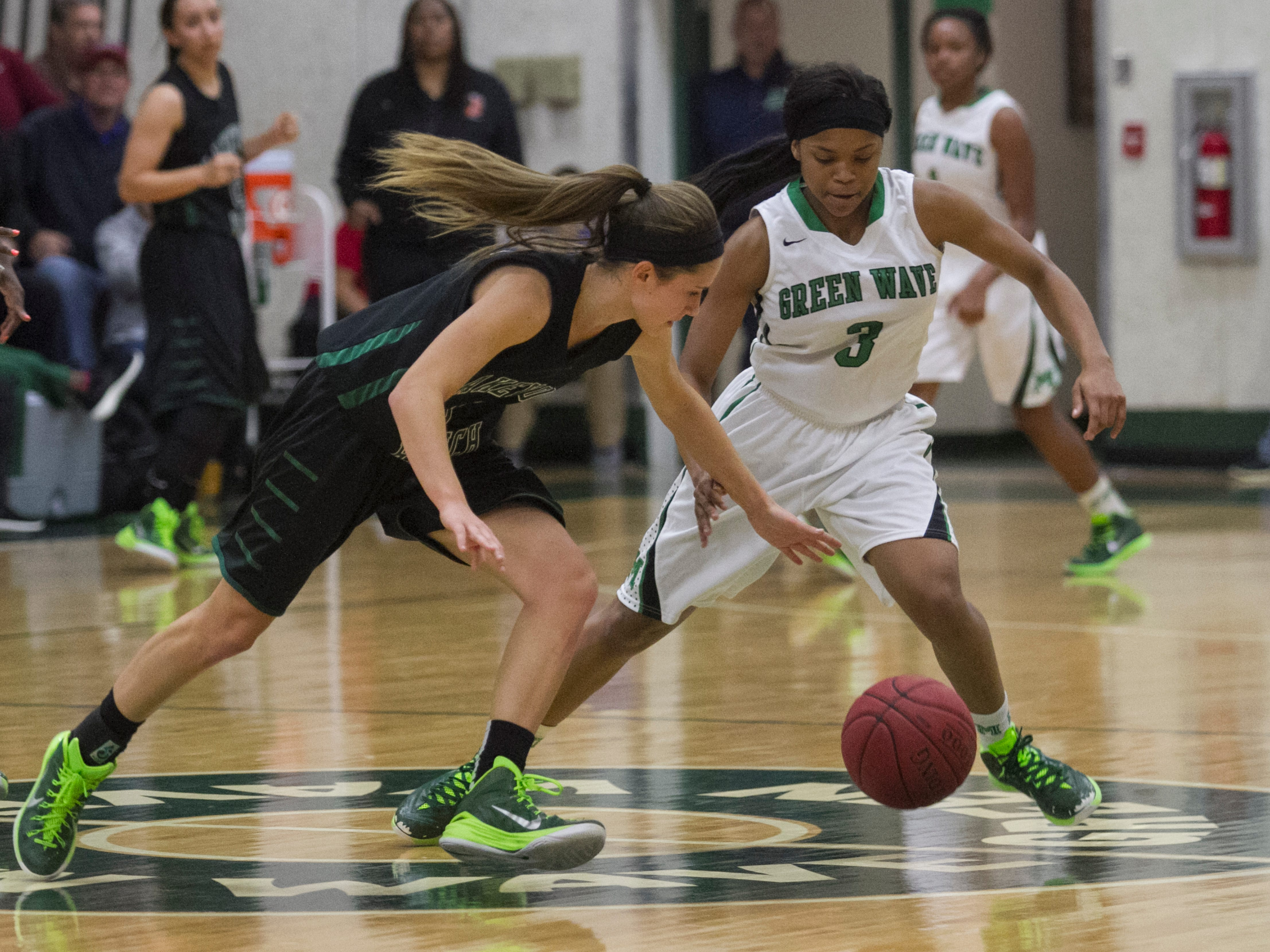 Amanda Inscore / News-PressDestanni Henderson of Fort Myers steals the ball from Lakewood Ranch's Kaitlyn Scully in Saturday's girls regional basketball finals at Fort Myers High School. Destanni Henderson of Fort Myers steals the ball from Lakewood Ranch's Kaitlyn Scully in the girls regional basketball finals on Saturday, February 14, 2015, at Fort Myers High School.