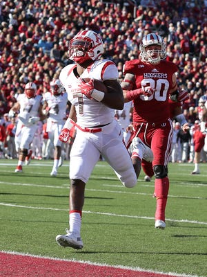 Rutgers Scarlet Knights running back Robert Martin (7) runs by Indiana Hoosiers defensive back Chase Dutra (30) for a touchdown in the first half of their game.