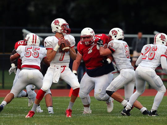 Bound Brook quarterback David LePoidevin looks to pass