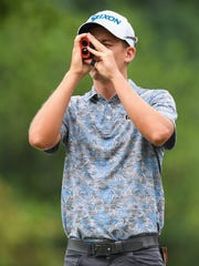 Andrew Putnam checks the yardage from the 1st tee with a rangefinder during the third day of action in the BMW Charity Pro-Am on Saturday, May 20, 2017 at Thornblade Club.