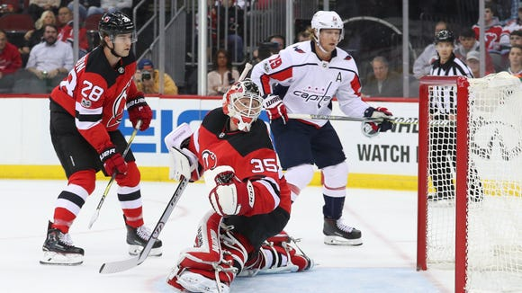 New Jersey Devils goalie Cory Schneider (35) looks back at a goal by Capitals right wing T.J. Oshie (not pictured) during the first period at Prudential Center on Friday, Oct. 13, 2017.