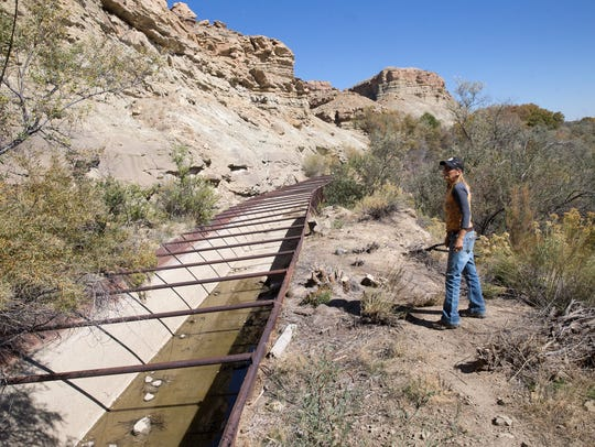 Farmers Mutual Ditch president Danene Sherwood talks about needed repairs Monday on the Farmers Mutual Ditch.