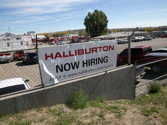 In this file photo, a hiring sign for Halliburton is pictured on Tuesday, Oct. 17, 2017 on East Main Street in Farmington.