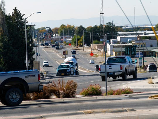 Traffic moves along the intersection of East Murray Drive and East Broadway Avenue on Tuesday in Farmington.