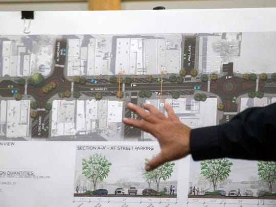Art Garcia, a senior engineer with Occam Engineers Inc., talks about one of several plans for street parking on Main Street during an October 2017 presentation at the Complete Streets Headquarters at 119 West Main Street in Farmington. Updated project renderings are on the way.