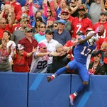 LeSean McCoy celebrates one of  his three touchdowns in a 45-16 win over the 49ers.