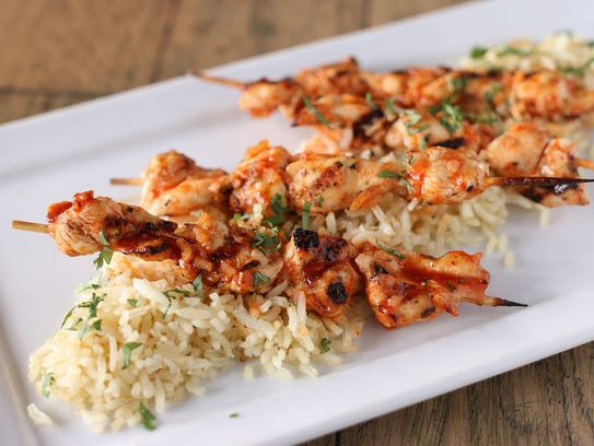 Sriracha chicken skewers with basmati rice at Char