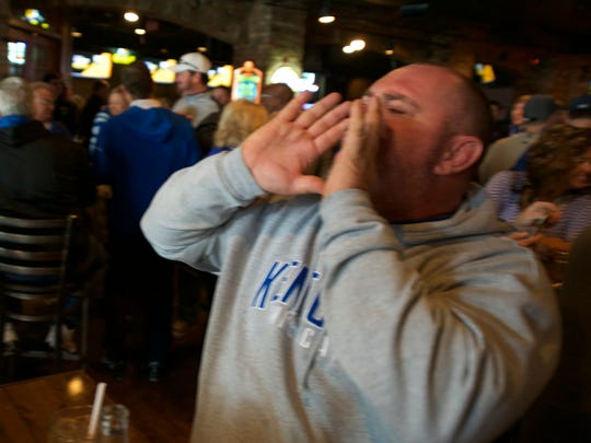 "Kentucky fan Chris Wethington yells ""Blue"" in Bailey's"