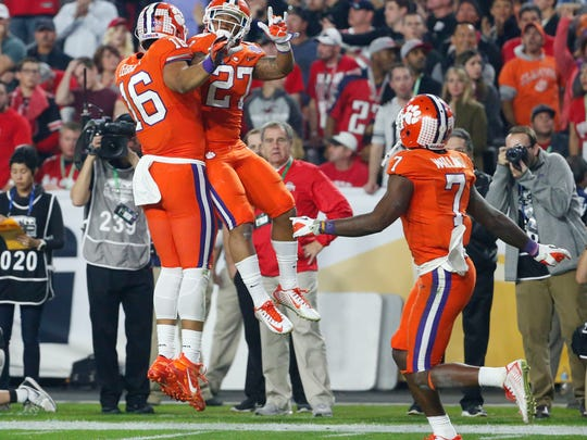Clemson Tigers tight end Jordan Leggett (16) and Clemson Tigers running back C.J. Fuller (27) celebrate a touchdown against Ohio State during the second quarter of the College Football Playoff Semifinal game in the PlayStation Fiesta Bowl on Dec. 31, 2016, at University of Phoenix Stadium in Glendale, Arizona.