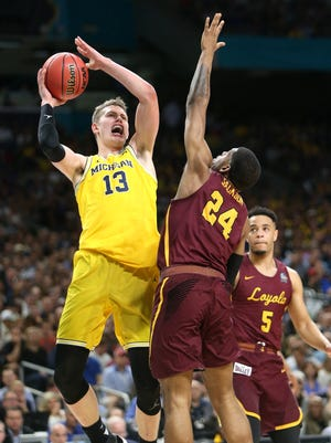 Michigan forward Moritz Wagner shoots over Loyola-Chicago forward Aundre Jackson during the national semifinal Saturday, March 31, 2018, at the Alamodome in San Antonio.