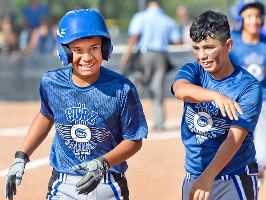 Joe Hernandez, of the Cruces Cubz, is all smile after