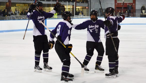 John Jay celebrates a goal during a 6-3 loss to Rye