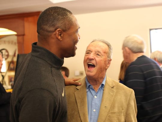 Former FSU football coach Bobby Bowden shares a laugh with Seminoles receivers coach Lawrence Dawsey on Saturday.