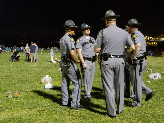 Kentuck State Troopers patrol the Waterfront Park great lawn after Thunder Over Louisvile. April 12, 2014.