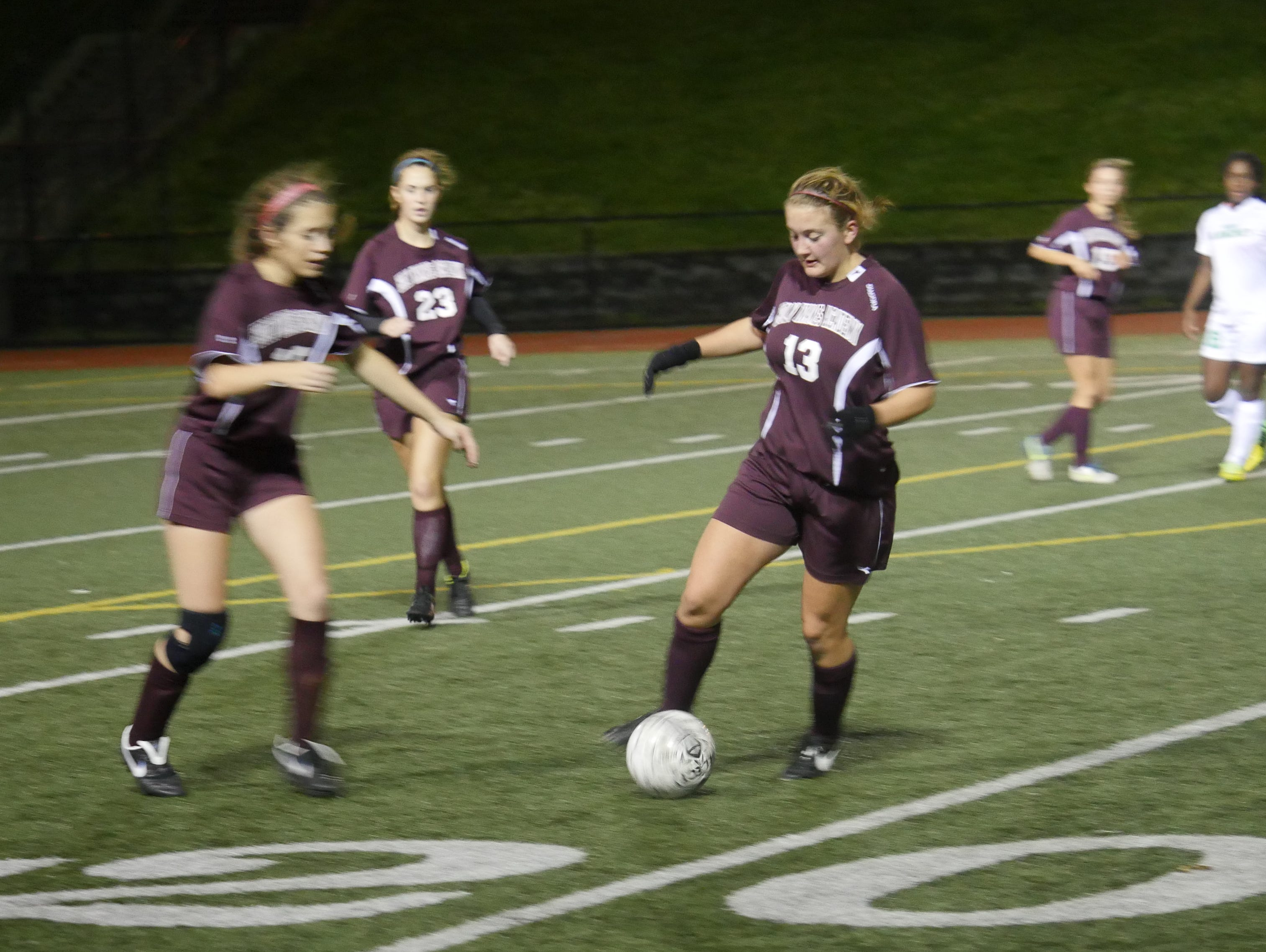 Holy Names midfielder Caroline Hennes dribbles the ball during the 2014 Metro League championship match.
