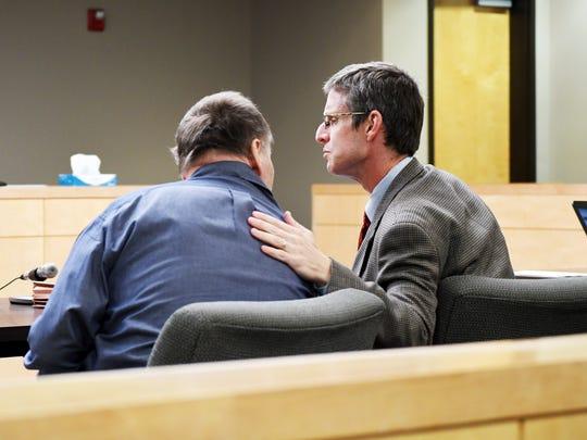 John P. Roberts talks with bis attorney James Egan