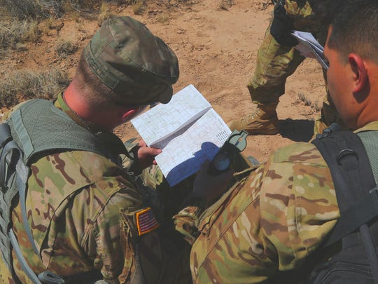 Pilots and flight crews from 2nd Battalion, 501st Aviation Regiment sharpen their survival skills, such as land navigation, during a field training exercise.