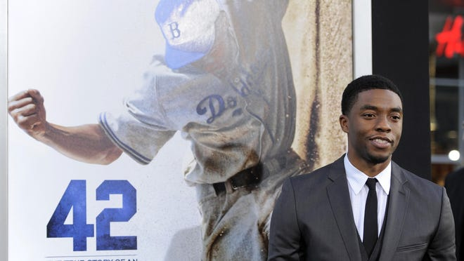 """Chadwick Boseman, who plays baseball legend Jackie Robinson in """"42,"""" poses at the Los Angeles premiere of the film at the TCL Chinese Theater in Los Angeles. Actor Chadwick Boseman, who played Black icons Jackie Robinson and James Brown before finding fame as the regal Black Panther in the Marvel cinematic universe, has died of cancer. His representative says Boseman died Friday, Aug. 28, 2020 in Los Angeles after a four-year battle with colon cancer. He was 43."""