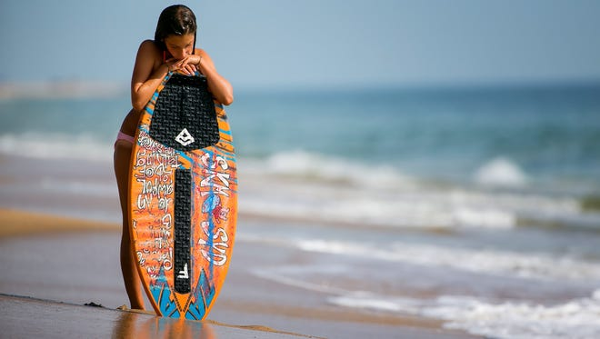 Sydney Pizza,12, practices at Dewey Beach as she prepares to compete at The Zap World Championship of Skimboarding in Dewey Beach this weekend.