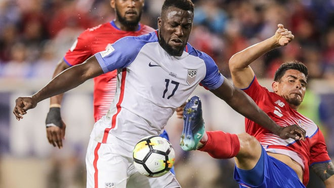 Jozy Altidore (17) plays the ball against Costa Rica defender Francisco Calvo (15).