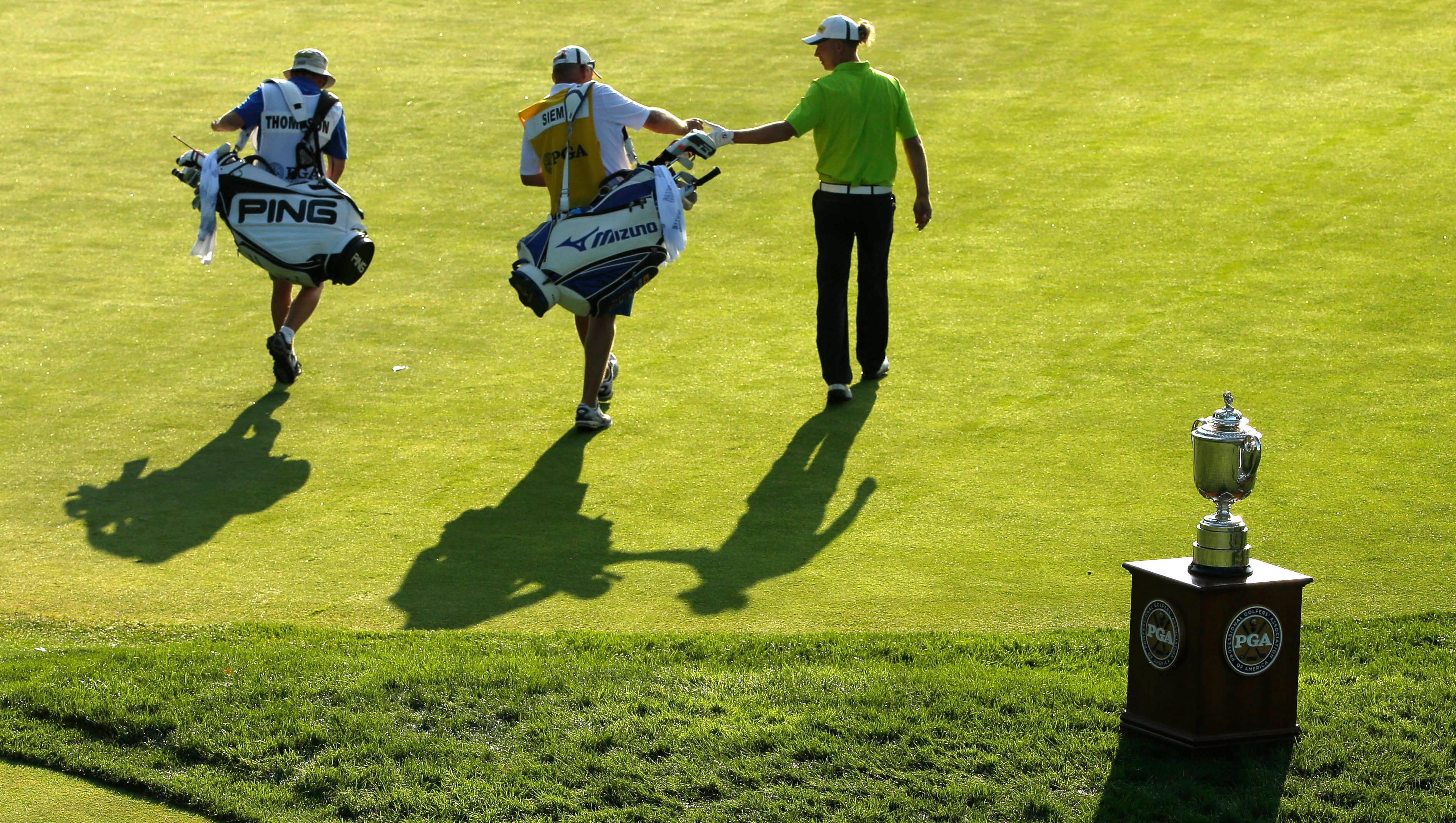 Marcel Siem walks past the Wanamaker Trophy on the first hole during the PGA Championship.