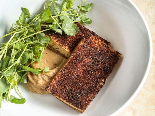 Mojo criollo sumac crusted tofu, eggplant puree, pea