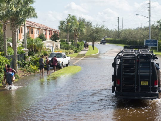 Fort Pierce Police shuttled Sabal Chase Apartments residents from their flooded neighborhood to a corner of the Walmart parking lot in Fort Pierce in the police department's Mine-Resistant Ambush Protected military vehicle following Hurricane Irma on Monday, Sept. 11, 2017, in Fort Pierce.
