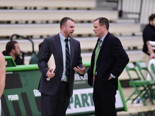 York Catholic graduate Jon Showers, left, is currently an assistant coach with the York College men's basketball team. York head coach Matt Hunter is at right. PHOTO COURTESY OF YORK COLLEGE ATHLETICS