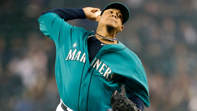 Mariners starting pitcher Felix Hernandez throws against the Oakland Athletics during the fourth inning at Safeco Field.