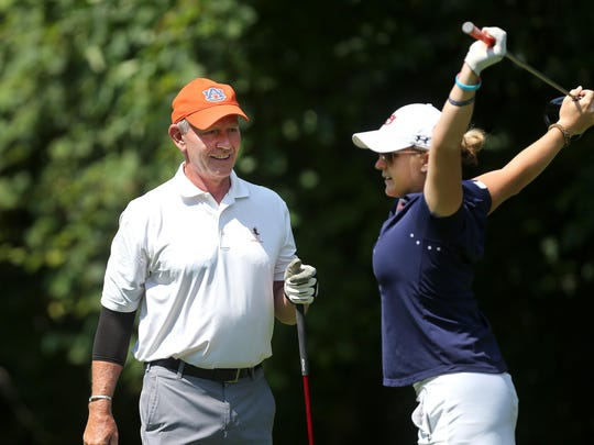 "Mike Downey, left, said his daughter, Danielle, would ""be very happy and humbled with all the things happening now,"" at the Toyota Danielle Downey Classic."