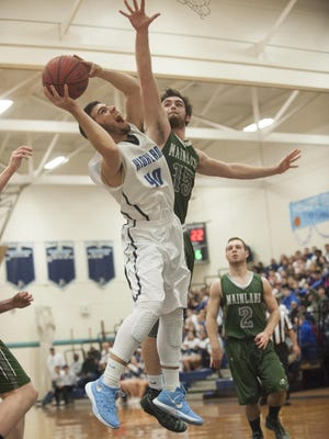 Highland's Dante Masino, left, goes for a layup against Mainland's Dean Deveney.
