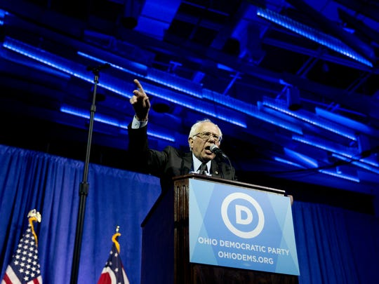 Democratic presidential candidate, Sen. Bernie Sanders, I-Vt., gestures as he speaks at the Ohio Democratic Party Legacy Dinner at the Greater Columbus Convention Center in Columbus on Sunday night.