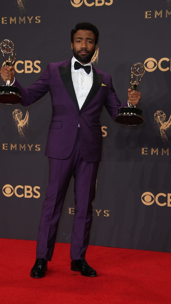 Donald Glover poses with his Emmy awards on Sunday