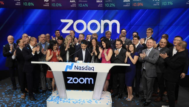 Eric Yuan and Zoom employees.