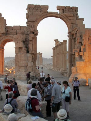 A file picture dated October 17, 2009 shows a group of tourists visiting the historic site of the ancient city of Palmyra, central Syria.