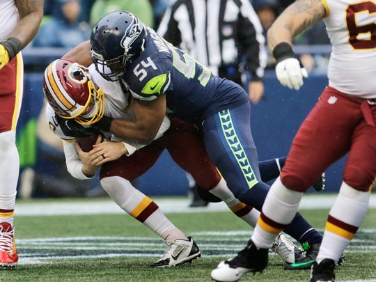 Seahawks linebacker Bobby Wagner Washington quarterback Kirk Cousins for a safety during a Nov. 5 game in Seattle. Wagner is a potential defensive player of the year, but the award rarely goes to middle linebackers.