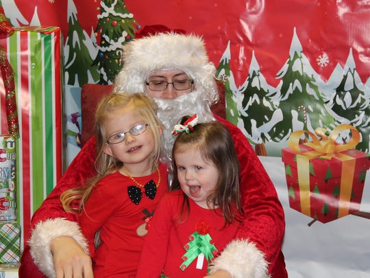 Lani Dirks, 5, and Cambrie Dirks, 3, meet Santa Claus