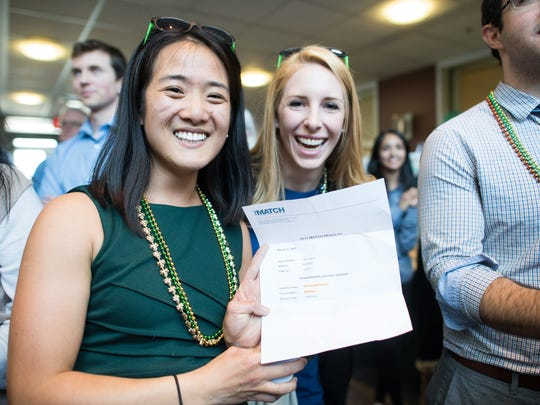 "Fourth-year medical student Jiaxin ""Jessica"" Huang, left, proudly shows off her Match letter announcing her acceptance into a pediatrics residency at the University of California, Davis Medical Center in Sacramento, Calif., at the Larner College of Medicine at the University of Vermont's Match Day event on Friday, March 17, 2017. Held annually the third Friday in March, Match Day is the day when graduating medical students learn the location and specialty of their U.S. residency program for the next three or more years."