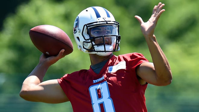 Tennessee Titans quarterback Marcus Mariota throws the ball during practice in June.