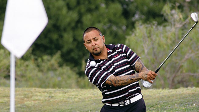 Local favorite Manny Grado Jr. chipped toward the flag during last year's tournament.