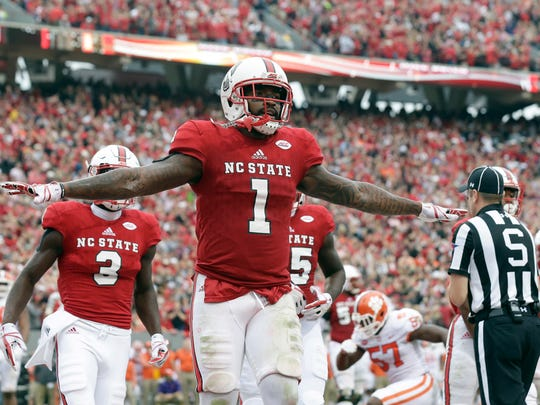 North Carolina State's Jaylen Samuels (1) celebrates his touchdown against Clemson during the first half of an NCAA college football game in Raleigh, N.C., Saturday, Nov. 4, 2017. (AP Photo/Gerry Broome)