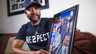 Eric Porter, Mesa, holds a photo of he and his wife, Amy, who died on October 20, 2017. Porter had to fight to receive his wife's life insurance benefits after her death.