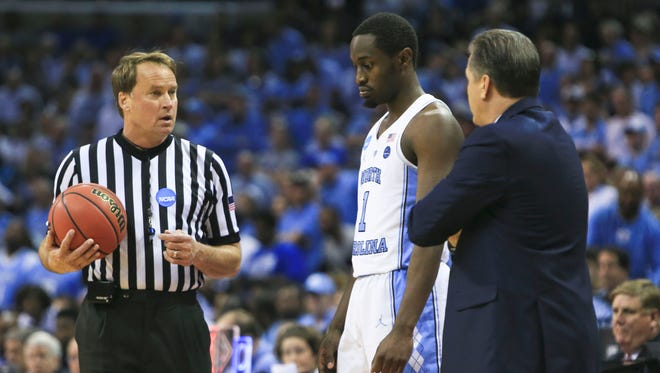 Kentucky coach John Calipari complains to a referee about the officiating during the game against North Carolina in the Elite Eight game at Memphis.